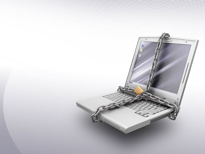 Computer with chains and a lock